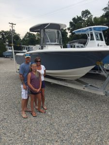 A family with a new 2014 Tidewater 230 CC from Jim's Marine in Galena, MD