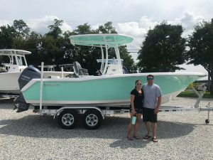 A couple next to their new 2018 Tidewater 220 CC from Jim's Marine in Galena, MD