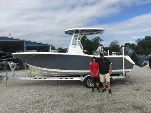 A father and son with a 2019 Tidewater 232 CC from Jim's Marine in Galena, MD