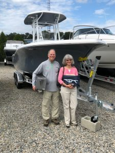 A couple with their 2019 Tidewater 220 LXF from Jim's Marine in Galena, MD